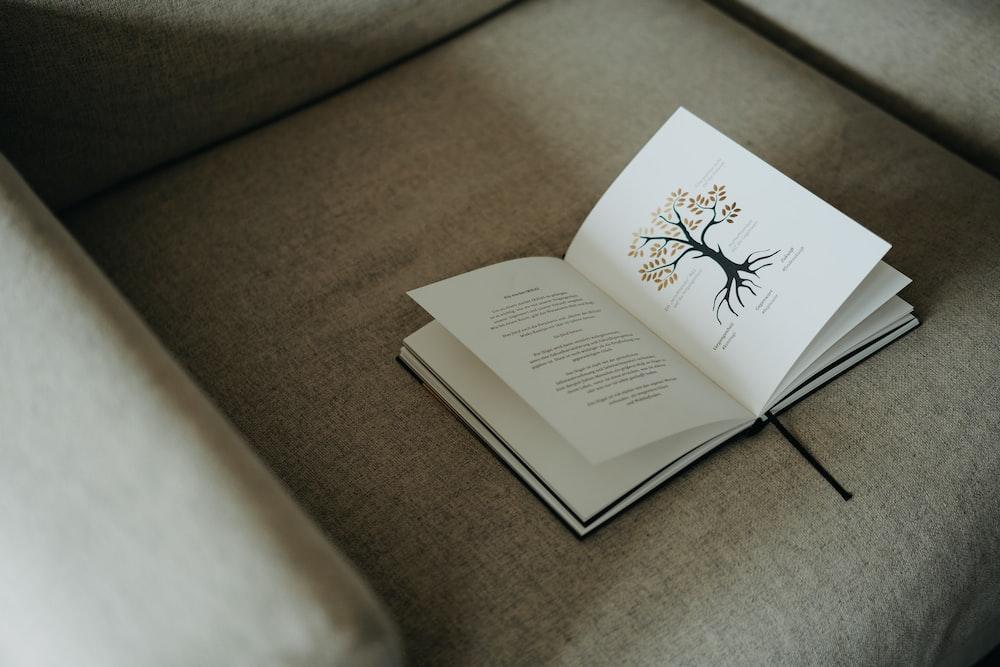 white book on brown textile