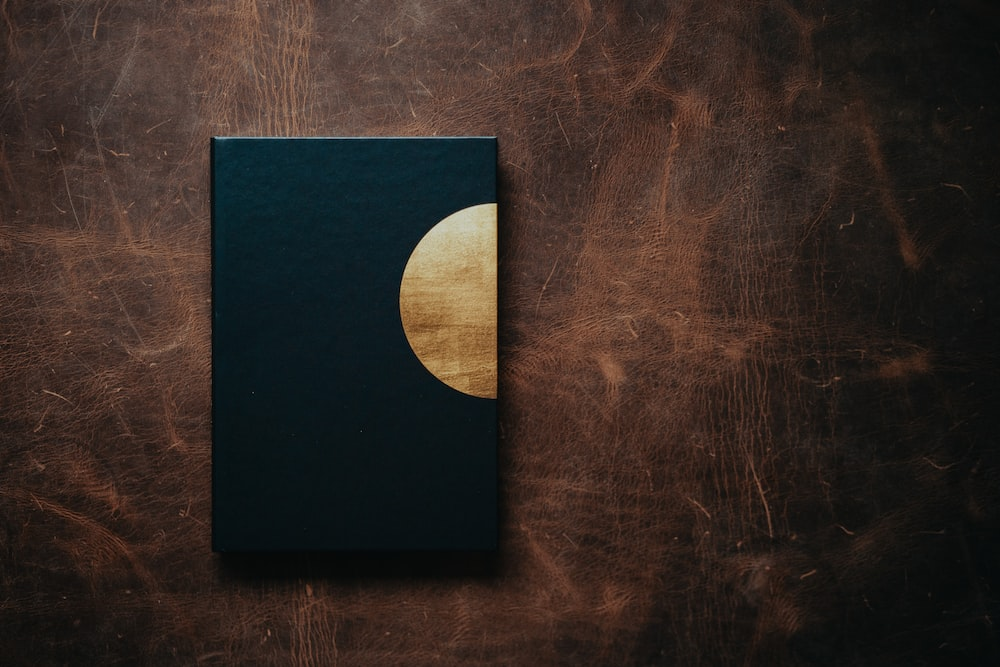 black square box on brown wooden table