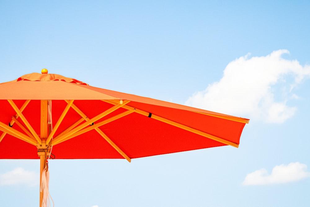 orange and white umbrella under blue sky during daytime