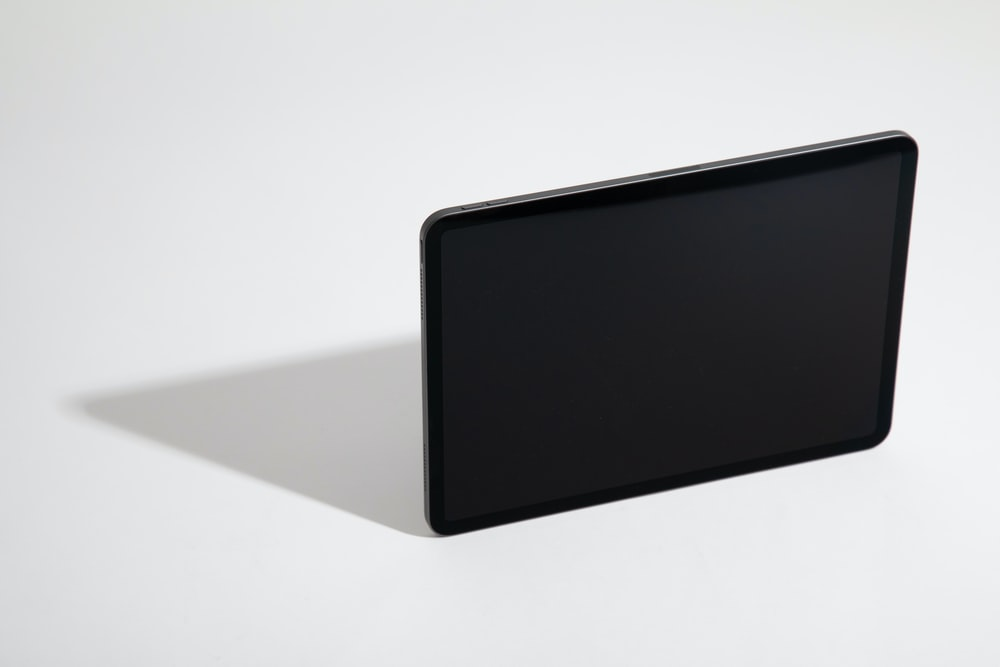 black tablet computer on white table