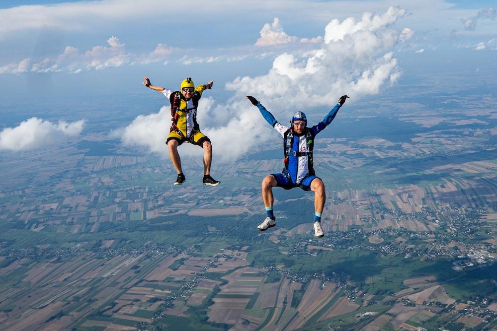 2 men jumping on air