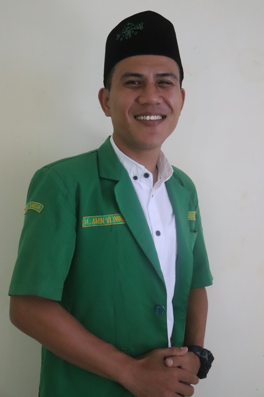 man in green polo shirt smiling