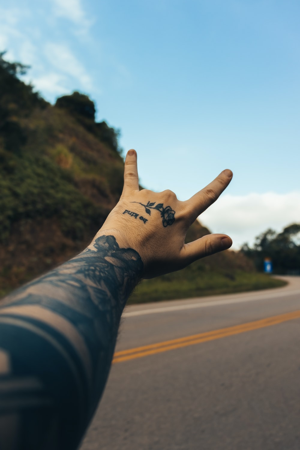 person with i love you hand tattoo
