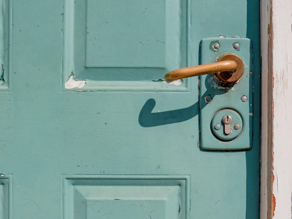 white wooden door with brass door lever