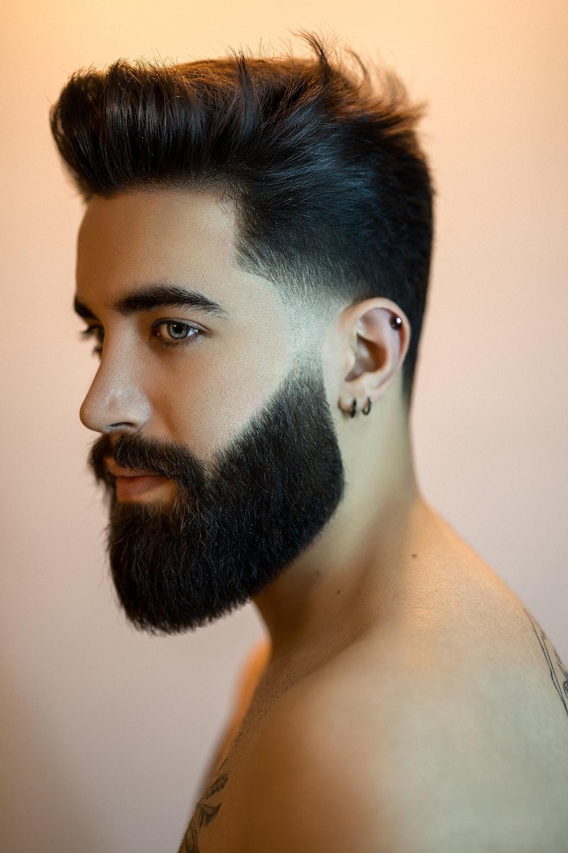 topless man with black beard
