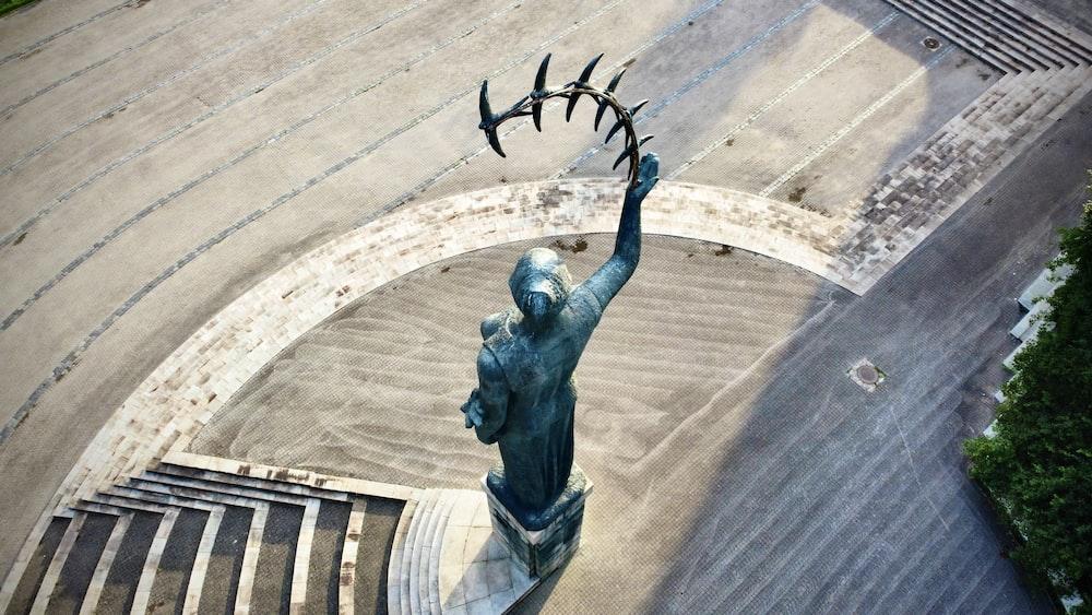 grey concrete statue of a man