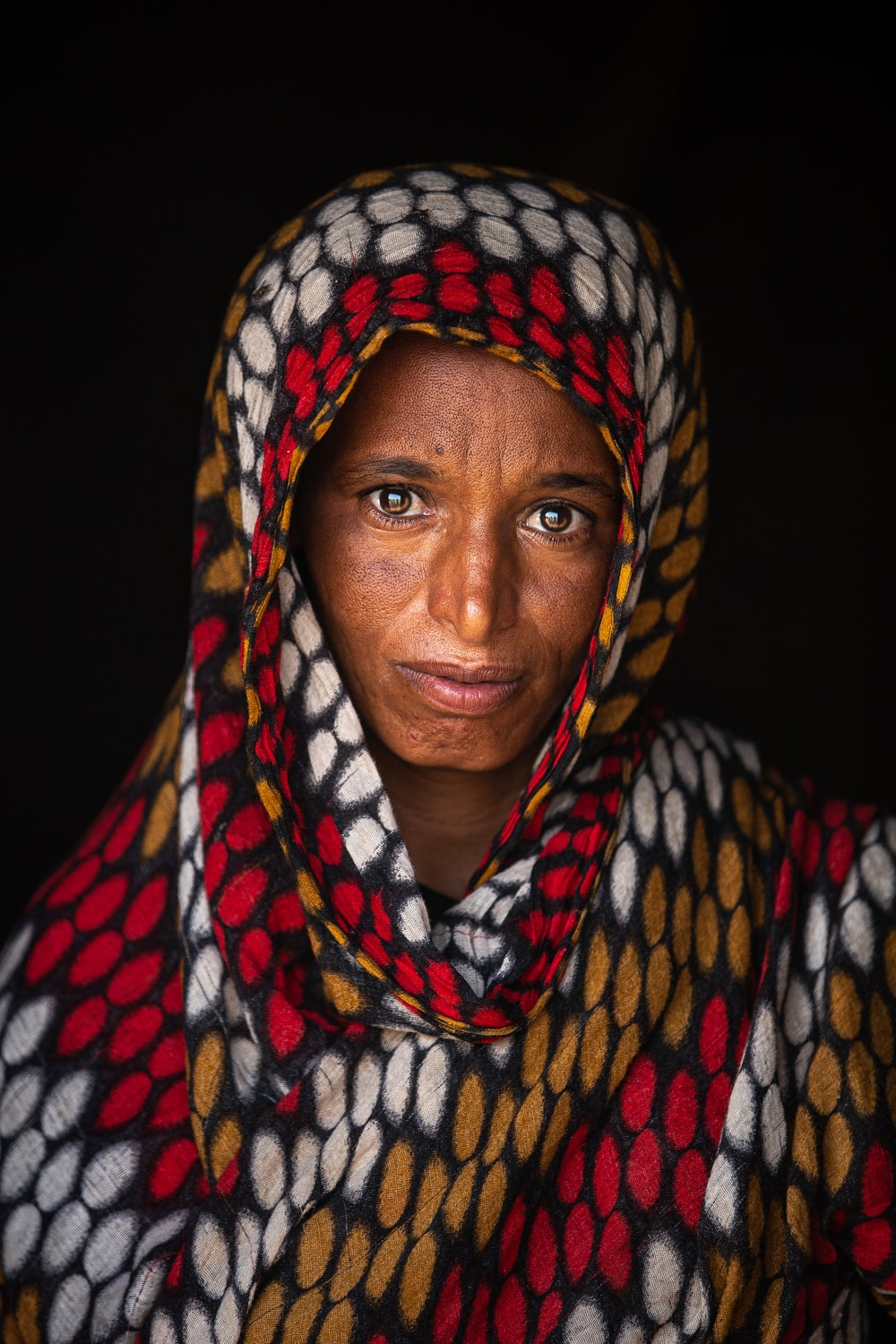 woman in blue white and red scarf