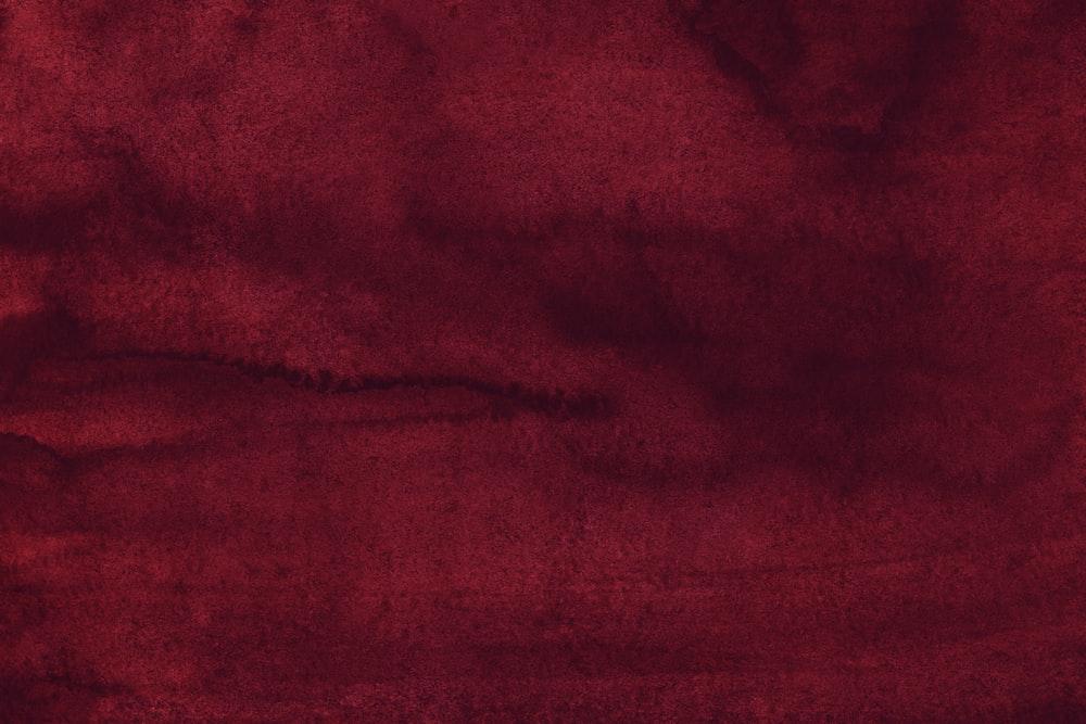 red textile on white textile