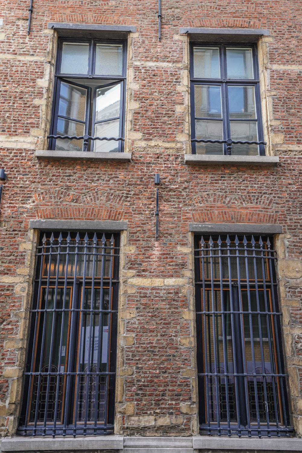 brown brick building with windows