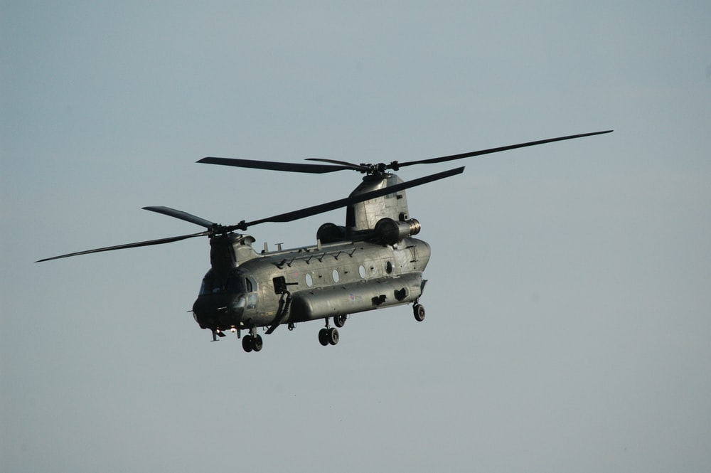 gray helicopter flying in the sky during daytime