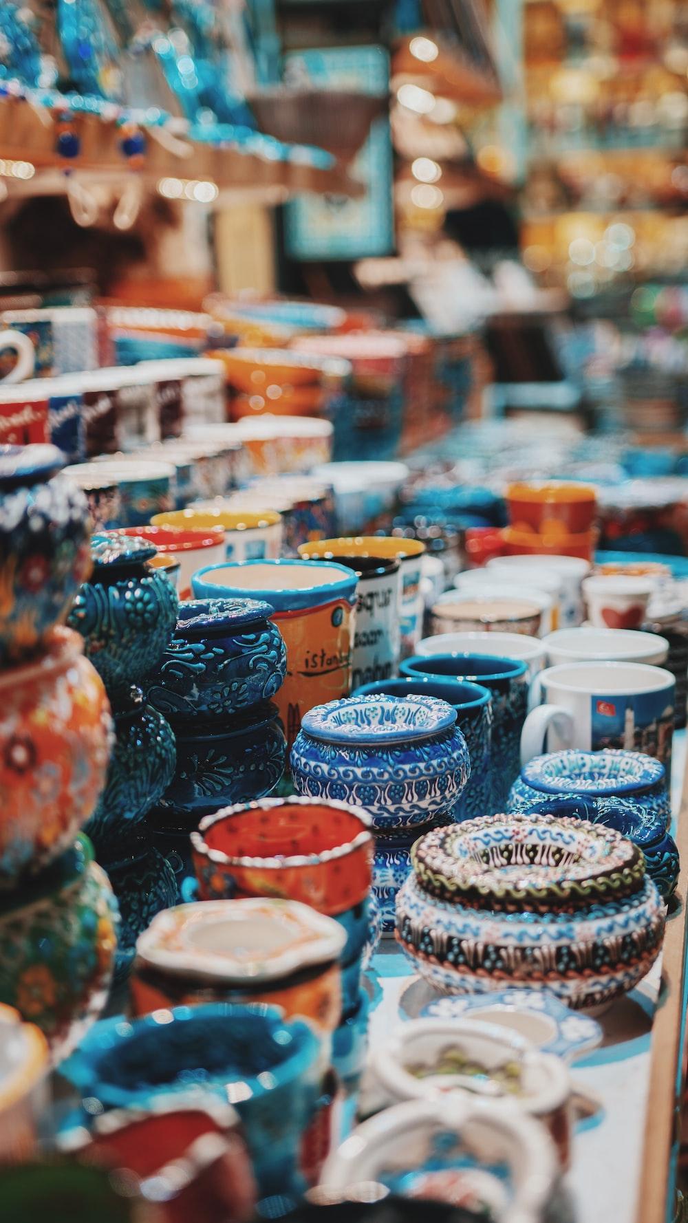 blue and orange ceramic jar