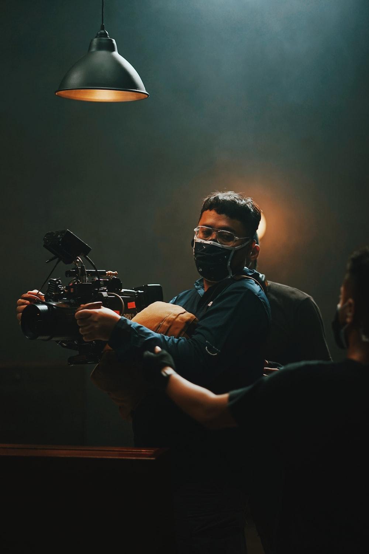 man in black shirt wearing black goggles