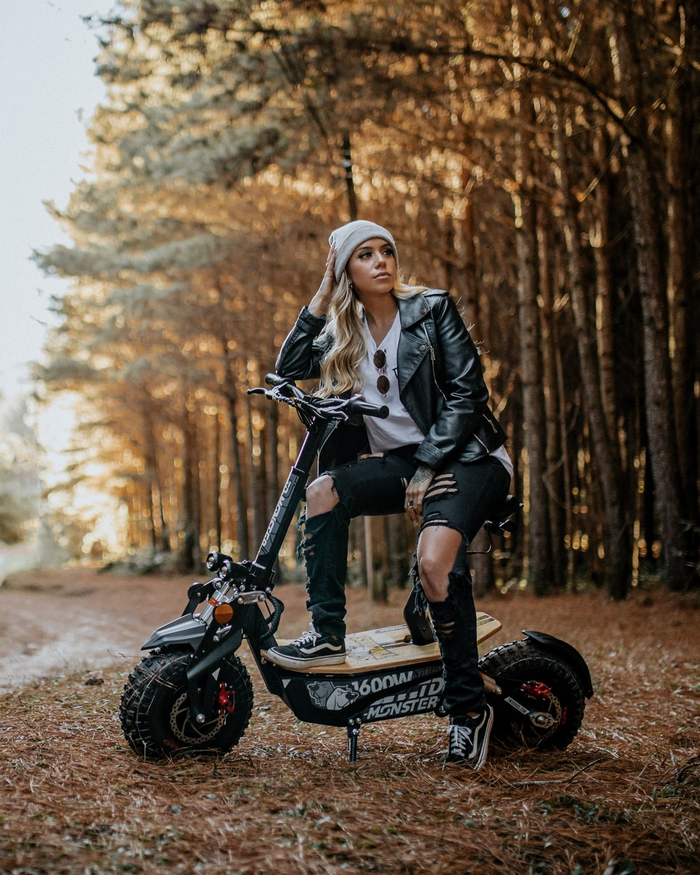 woman in black jacket riding on black motorcycle