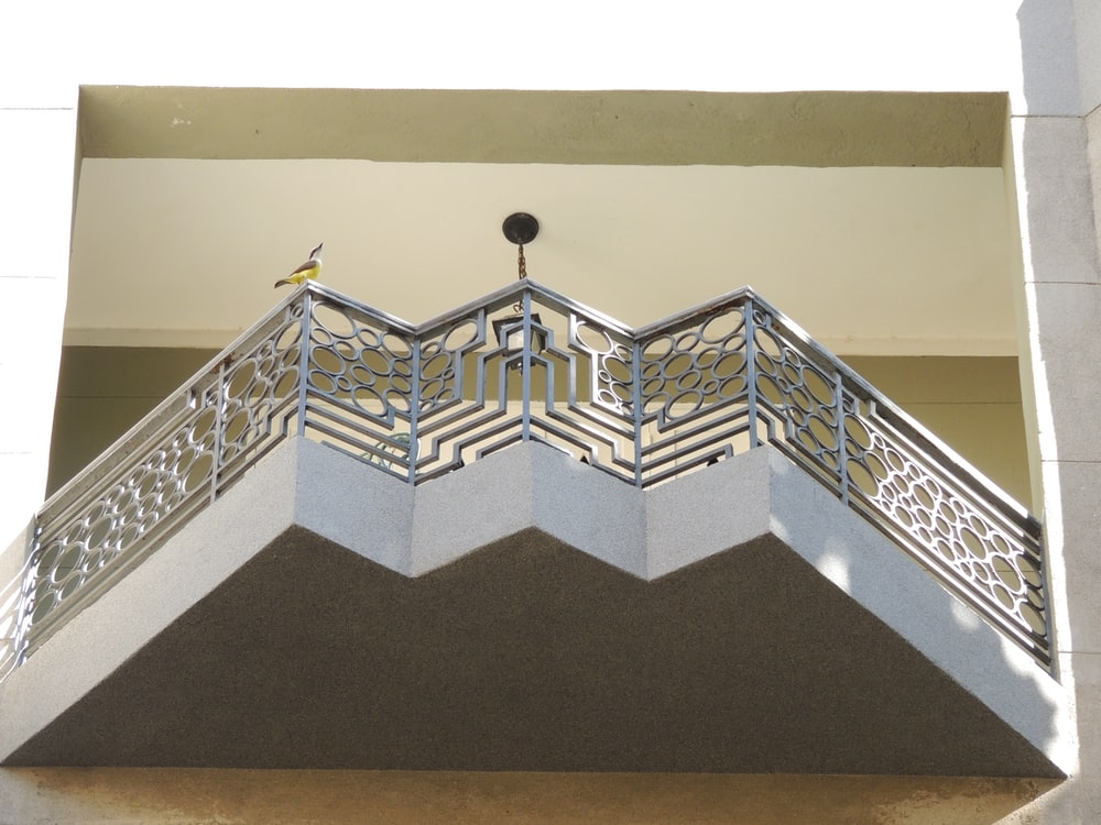 blue and white staircase with blue railings