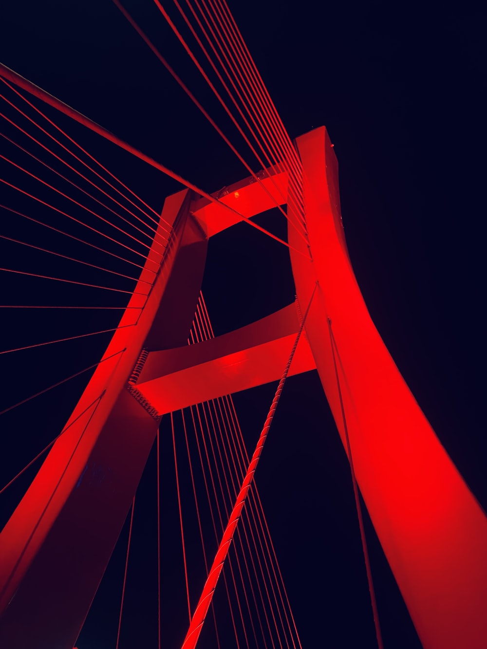 red bridge with white lights