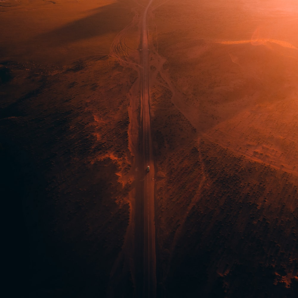 sun rays over brown mountains