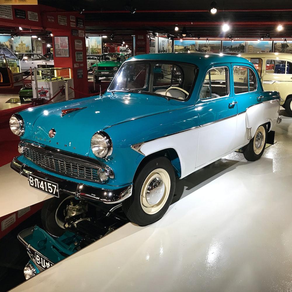 blue classic car in a room