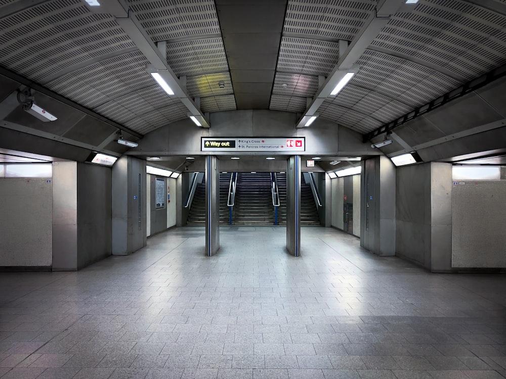 gray and black concrete hallway