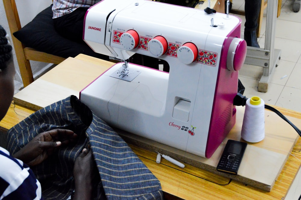 white and red sewing machine