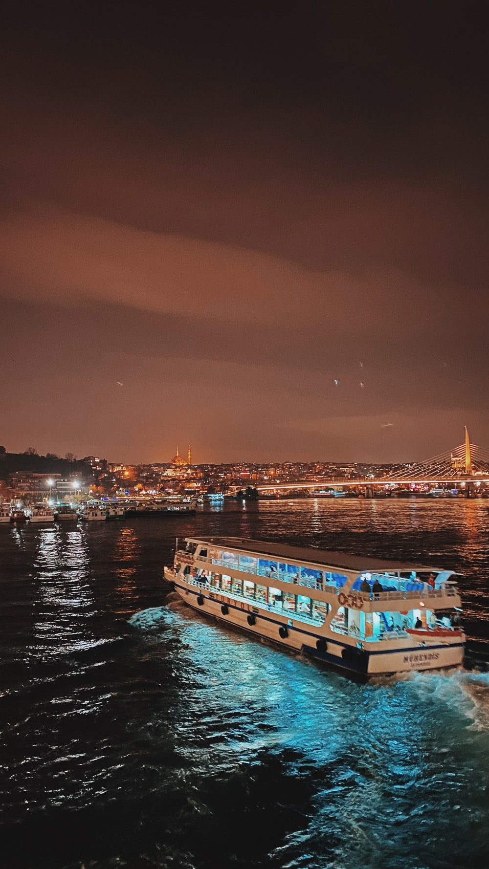 white and blue boat on water during night time