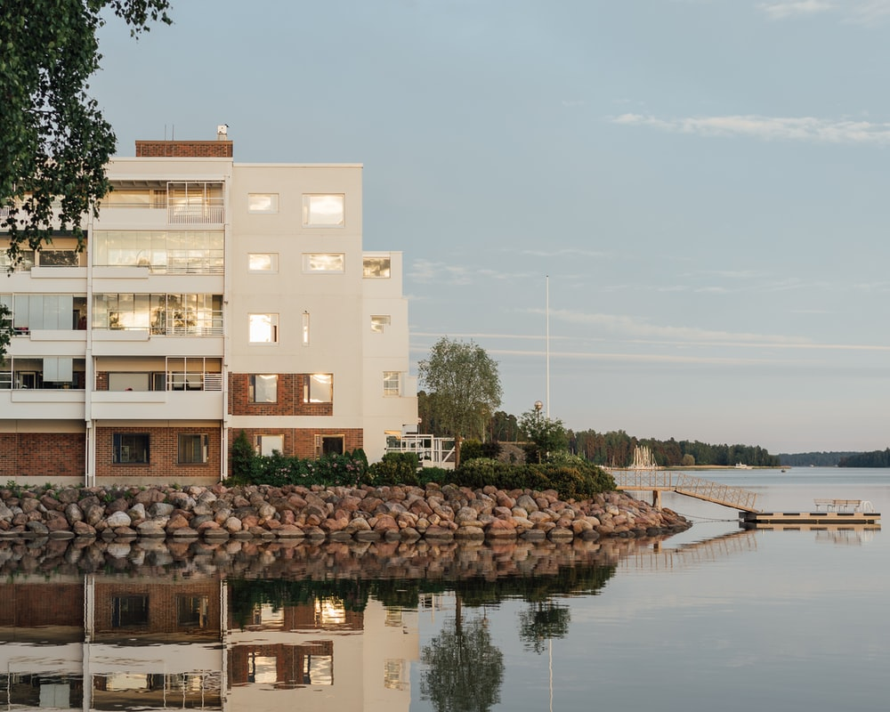 beige concrete building near body of water during daytime