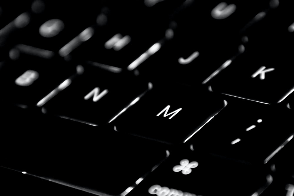 black computer keyboard in close up photography