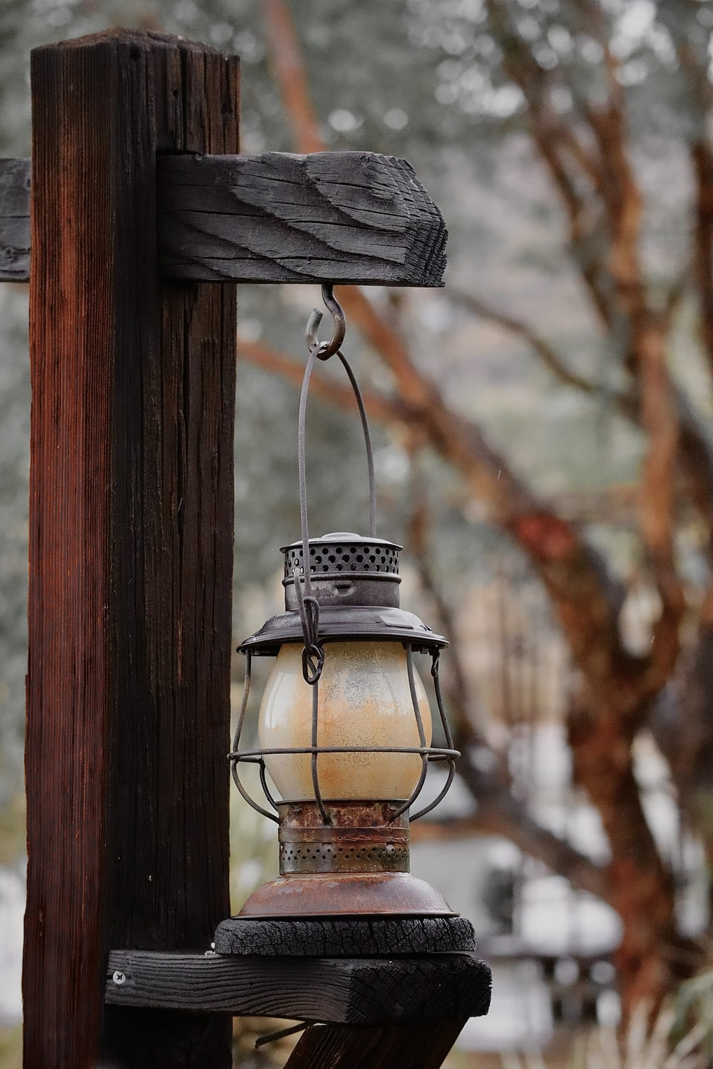 brown and white lamp on brown wooden post
