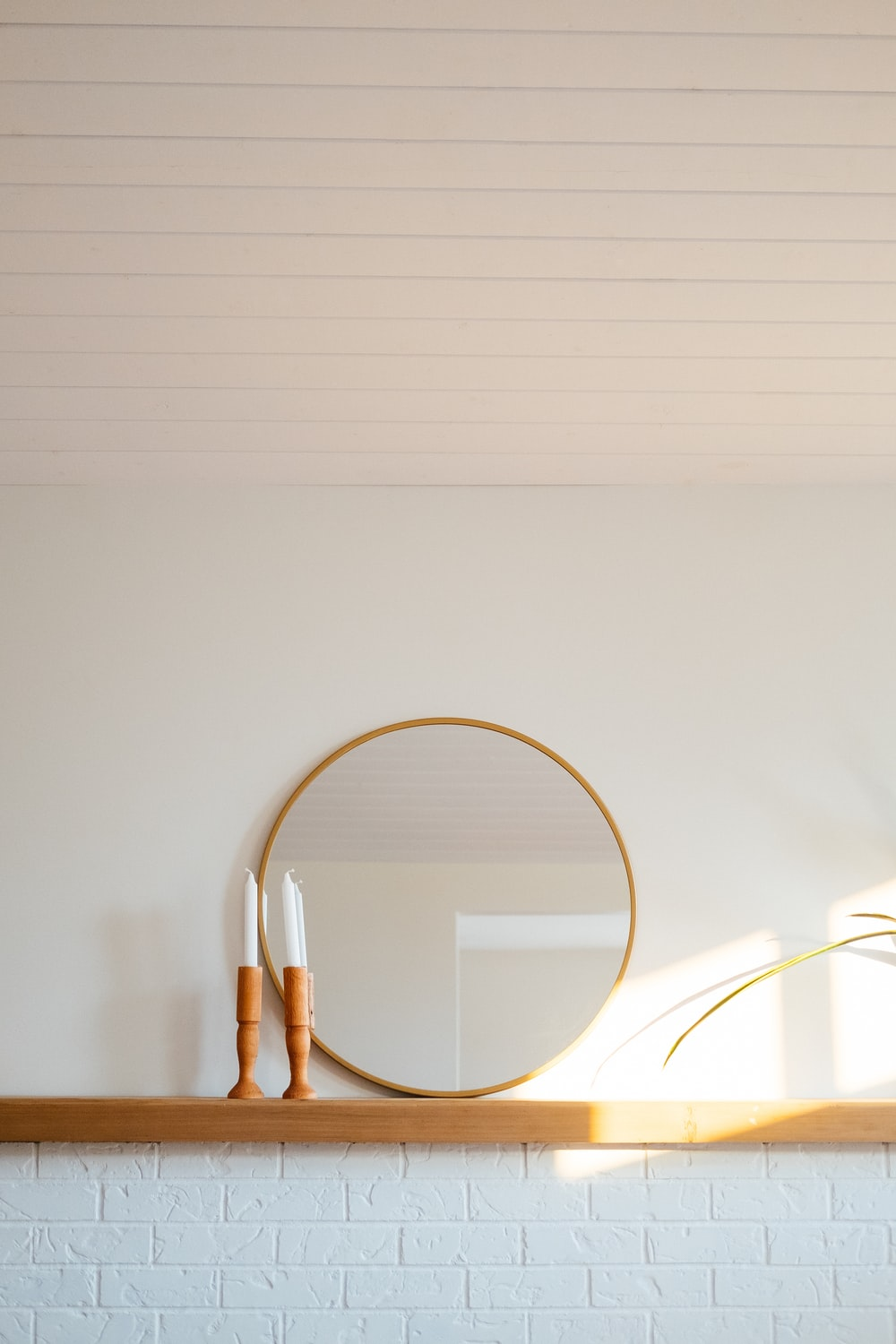 white and gold frame on white wall