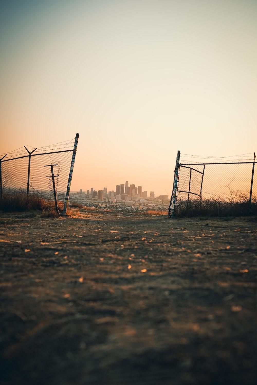 black metal fence on brown field