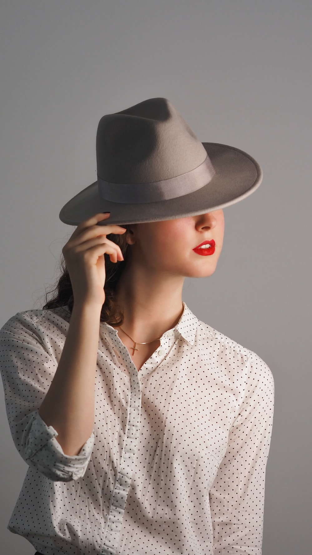 woman in gray hat and gray button up shirt