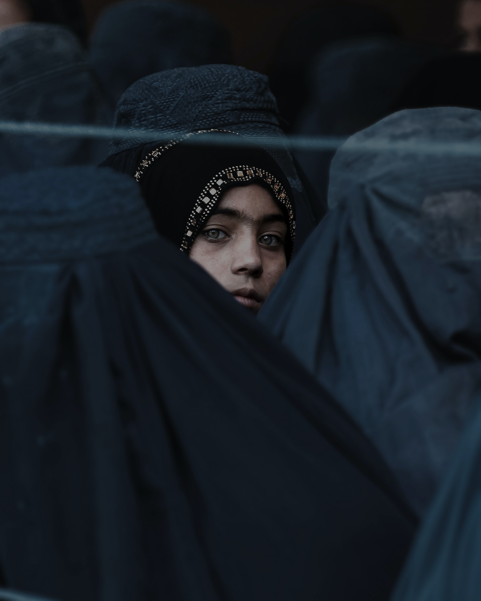 A Girl Looks on Among Afghan Women Lining Up To Receive Relief Assistance, During The Holy Month of Ramadan in #Jalalabad, #Afghanistan.