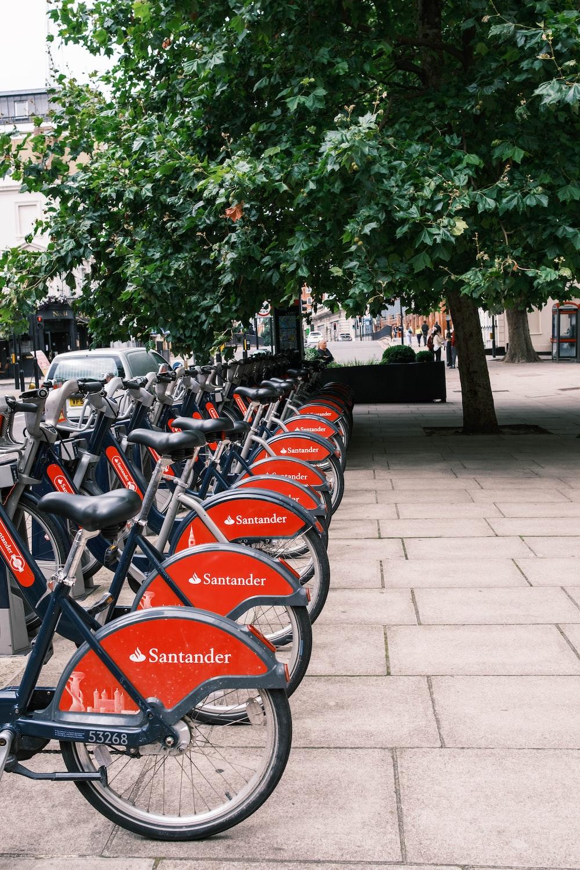 black and orange bicycles parked on sidewalk during daytime