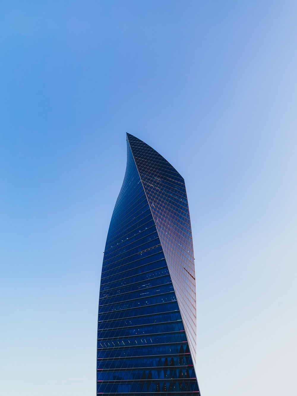 black and gray high rise building under blue sky during daytime