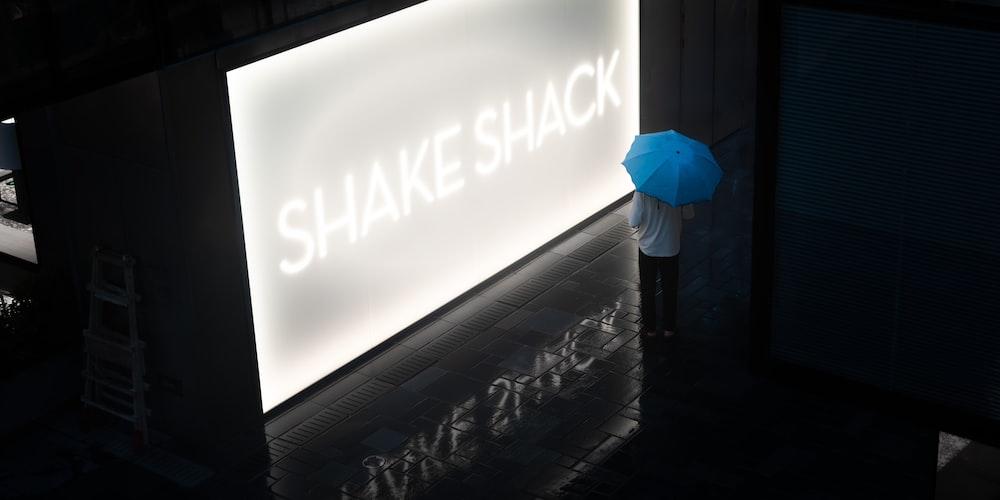 blue umbrella on white wall