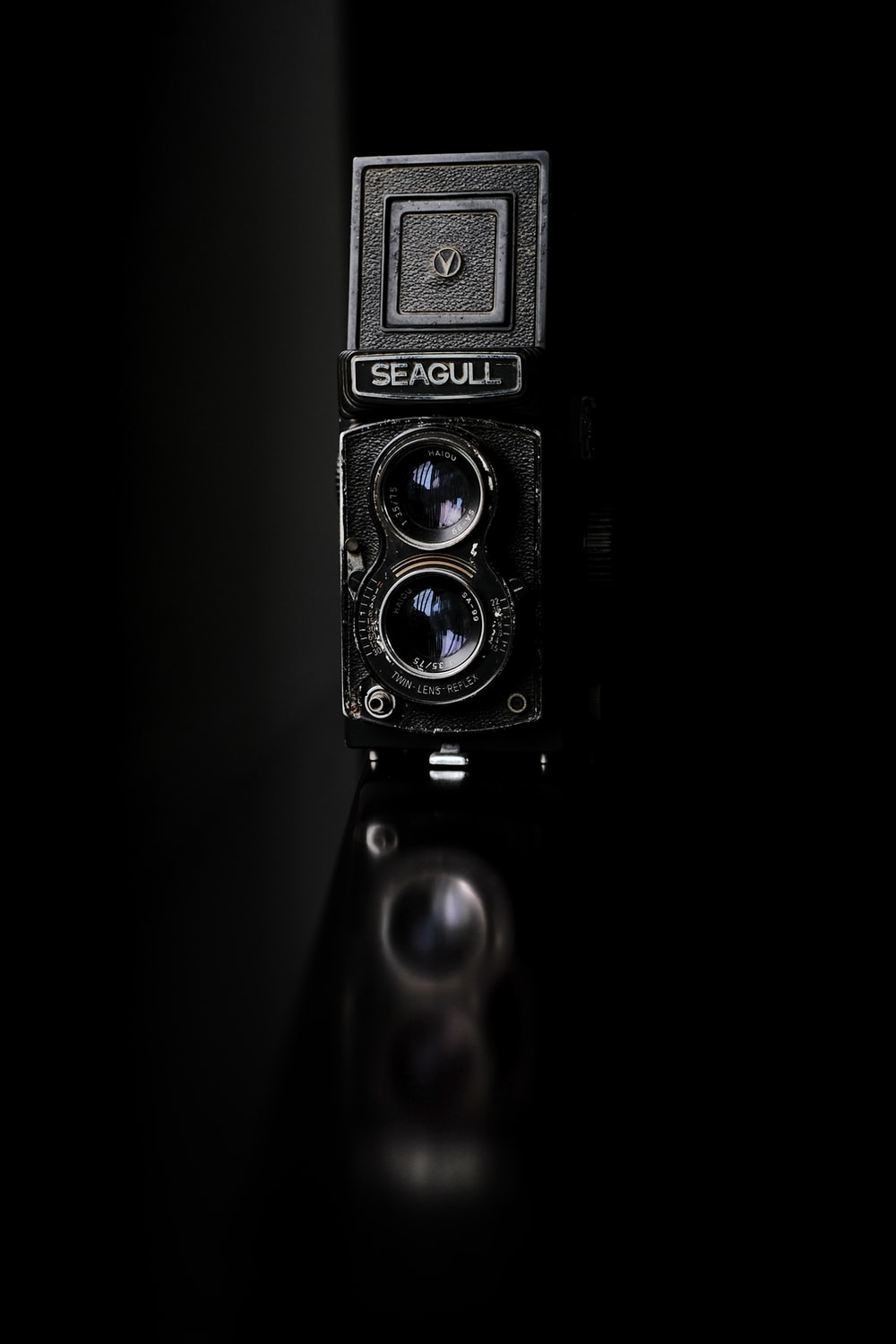 black and silver camera in black background