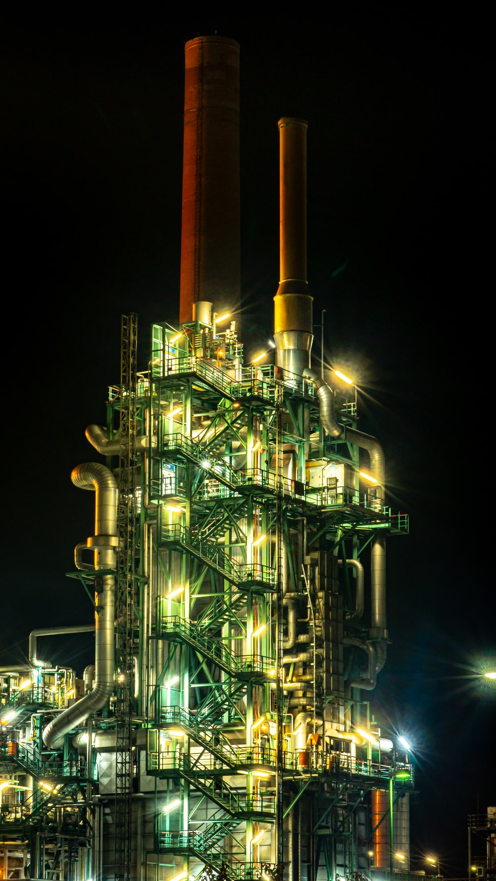brown and black factory during night time