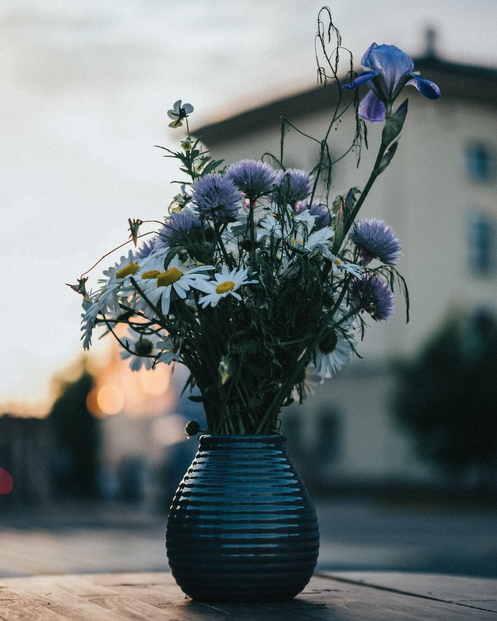 blue flowers in blue ceramic vase