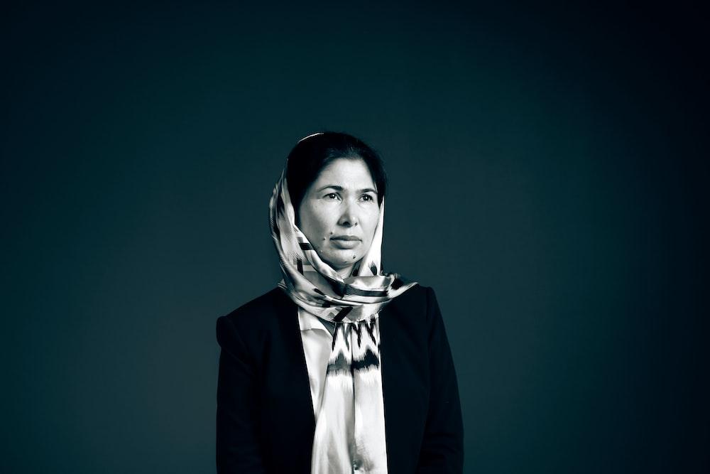 woman in white hijab and black blazer