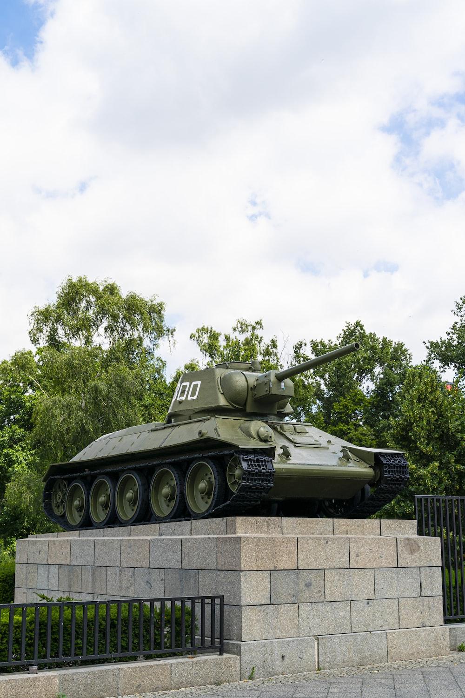 green battle tank under white clouds during daytime