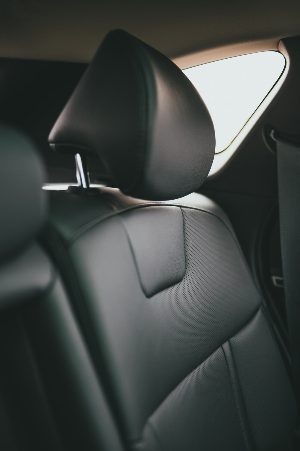 black leather car seat with black car seat