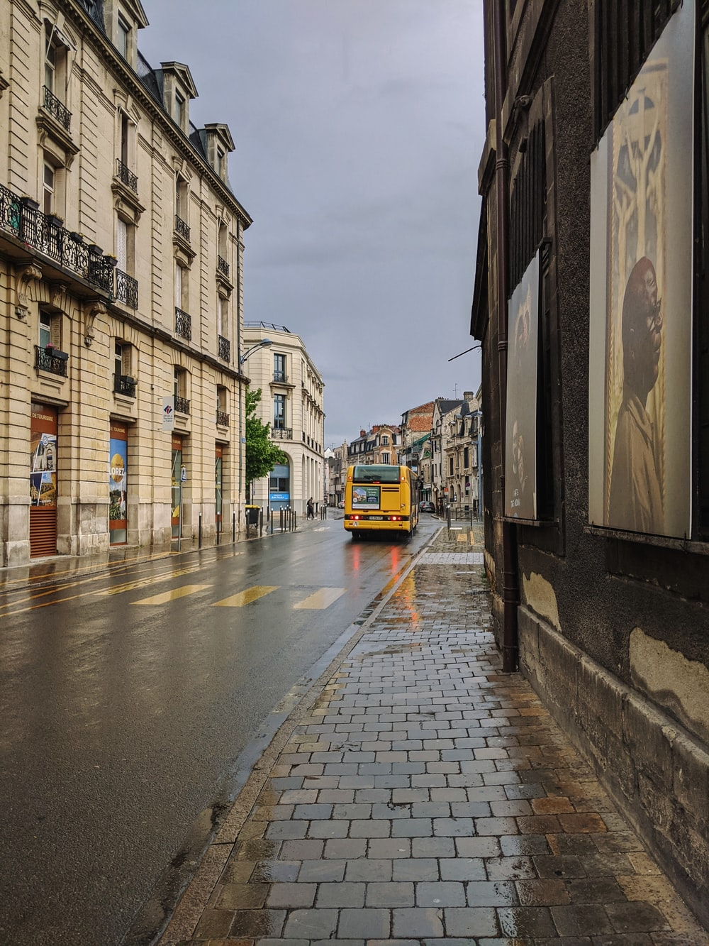 yellow bus on road during daytime
