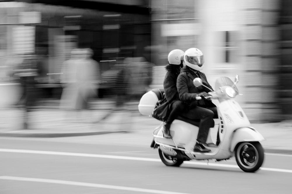 man riding motorcycle on road during daytime