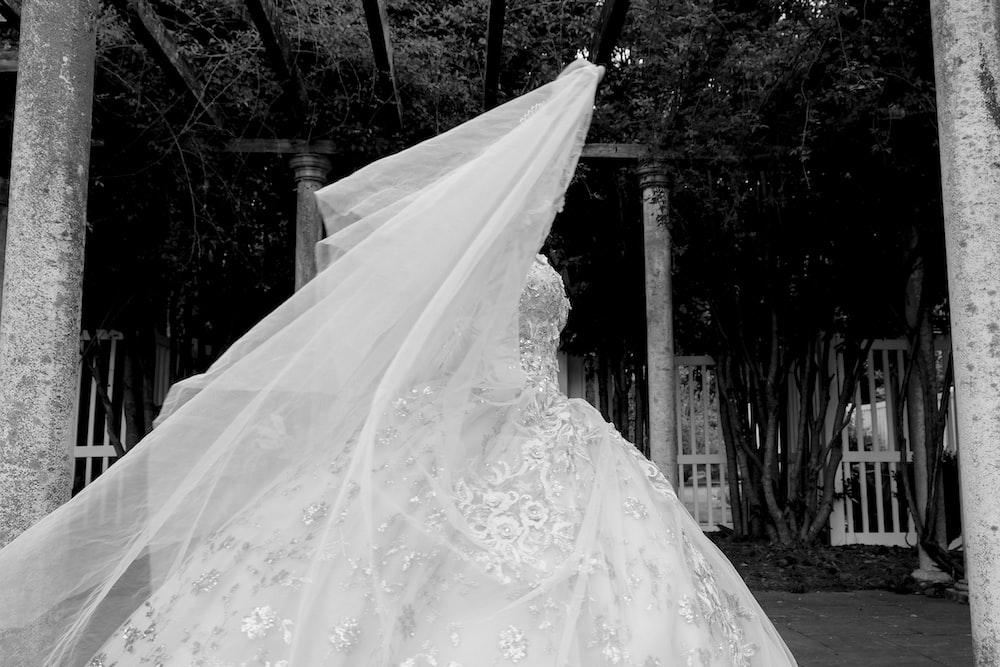 white floral wedding dress on black hanger