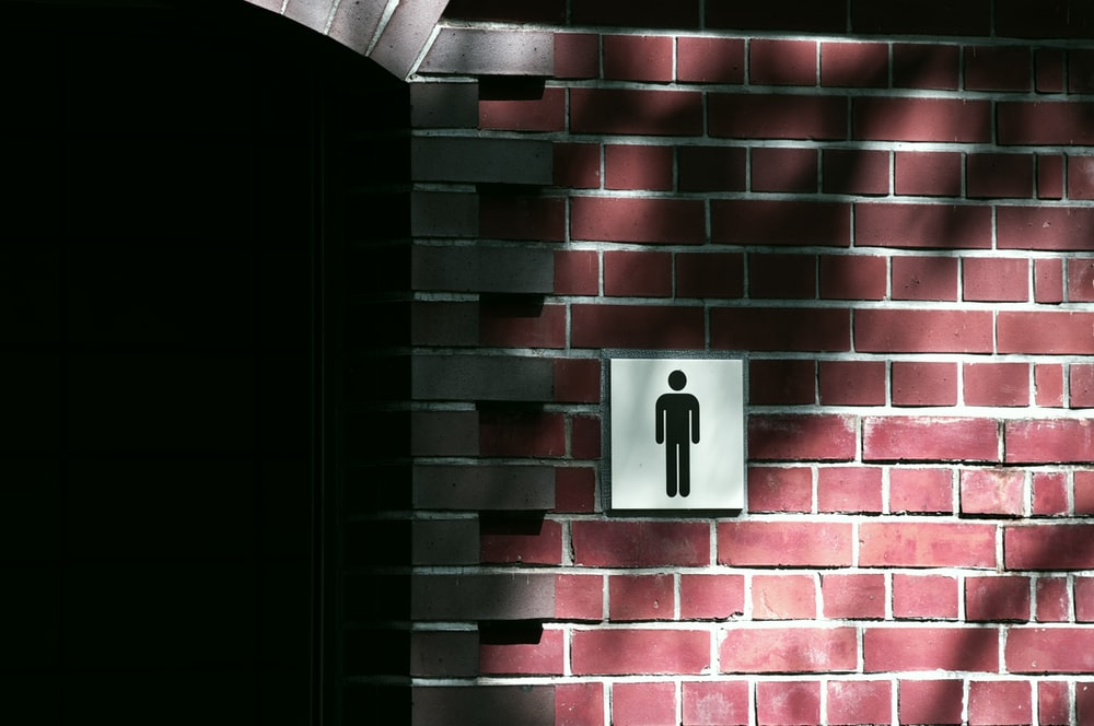 red brick wall with white light