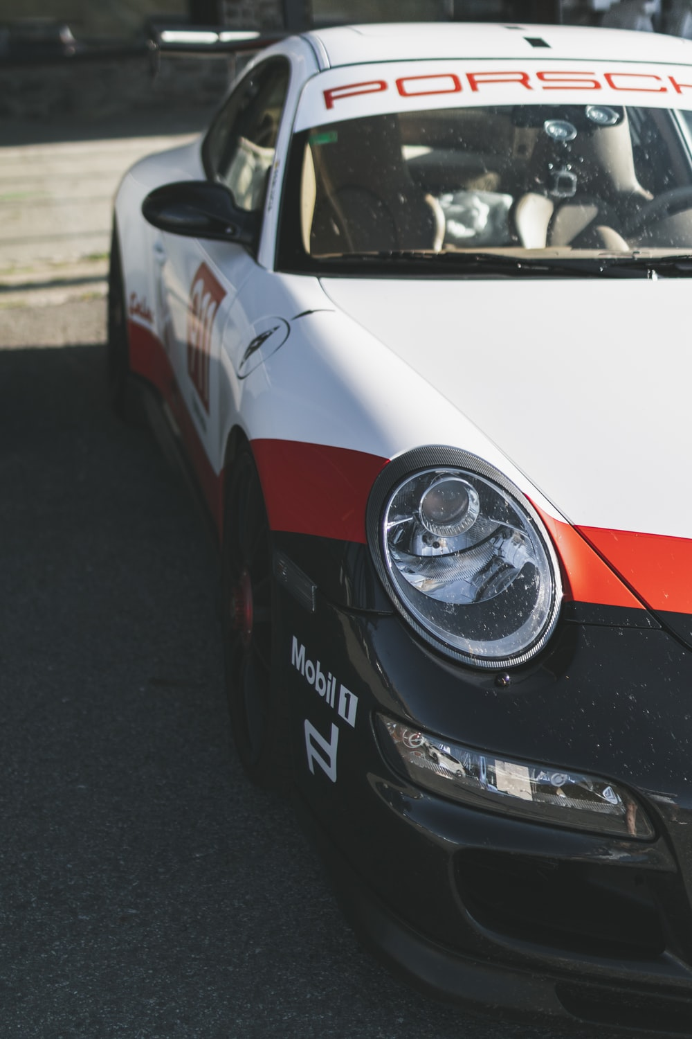 white and red porsche 911 on road during daytime