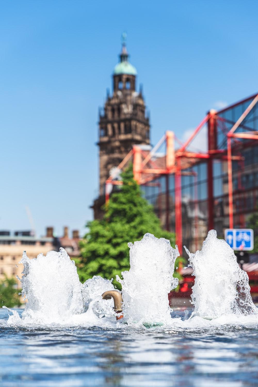 water fountain near red bridge during daytime
