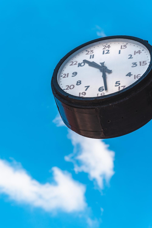 black and white analog clock at 10 10
