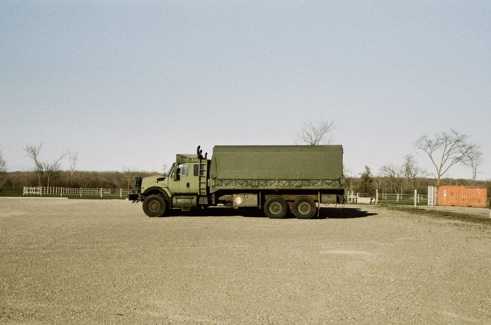 green truck on road during daytime