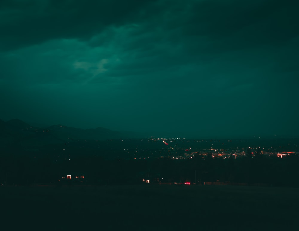 city lights turned on during night time