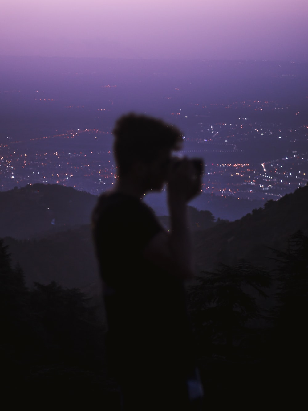 silhouette of woman standing on top of mountain during night time